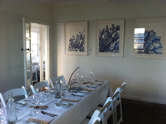 Table set for the Feast of the seven fishes at Nobby's Lighthouse Newcastle with works by Nicola Hensel